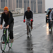 Nils and his friends returning from an early morning coffee ride, to open the shop on Saturday morning.