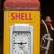 A vintage Shell petrol pump on display at Matthew's Vintage Collection  near Kaitaia.Northland, New Zealand. ..Matthew's Vintage Collection is a privately owned collection of vintage cars and machinery used in farming dating back to the early 1900's. Accumulated and restored by an avid vintage enthusiast over the last 40 years, covering over 1100 square meters of display area...Matthews Vintage Collection includes an extensive range of Farmall tractors covering a period from 1920's to 1950's as well as a variety of other makes..The selection of vintage cars including Nash's, Chevrolets and a Singer Roadster. Kaitaia Northland, New Zealand. 20th November 2010 Photo Tim Clayton..