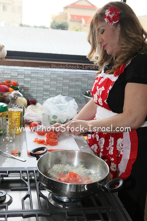 Smadar (Smady) Vaknin (Israeli Master Chef finalist) cooking in her kitchen