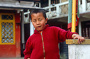 Samanera boy monk at Samten Choling Monastery, Ghum near Darjeeling, West Bengal, India