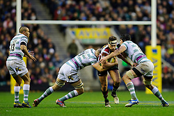 Harlequins replacement (#20) Tom Guest is tackled by London Irish replacement (#20) Jamie Gibson and Lock (#4) Bryn Evans during the second half of the match - Photo mandatory by-line: Rogan Thomson/JMP - Tel: Mobile: 07966 386802 29/12/2012 - SPORT - RUGBY - Twickenham Stadium - London. Harlequins v London Irish - Aviva Premiership - LV= Big Game 5.