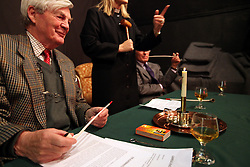 © under license to London News Pictures.  13/12/2010..Lord of the Manor Tony Jackson watches on as the age-old tradition of a candle auction takes place. The auction, held every three years, is where people bid to lease a local meadow while a candle containing a horse-nail burns...The person with the bid when the nail drops out of the specially-made tallow candle is declared the winner...The event, which originates from the early 1800s, was held at Aldermaston Parish Hall, Berkshire, with the local vicar as the auctioneer. Church wardens, in-keeping with tradition, are given pipes, although they were not allowed to light them...Picture credit should read: Rebecca Mckevitt/London News Pictures