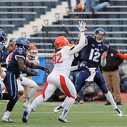 TOM KELLY IV &mdash; DAILY TIMES<br /> Villanova QB Chris Polony (12) fires off a pass over the head of SHS's PJ Hall (92) during the Sam Houston State University at Villanova University NCAA FCS Division 1 - AA quarterfinal game at Villanova Stadium.
