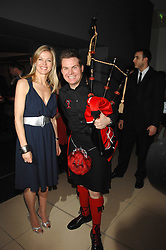 LADY HELEN TAYLOR and piper at 'Not Another Burns Night' in association with CLIC Sargebt and Children's Hospice Association Scotland held at ST.Martins Lane Hotel, London on 3rd March 2008.<br />