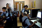 Girls student are following a computer lesson at a school run by Sonrisas de Bombay, a fast-growing Spanish NGO in Mumbai, India.