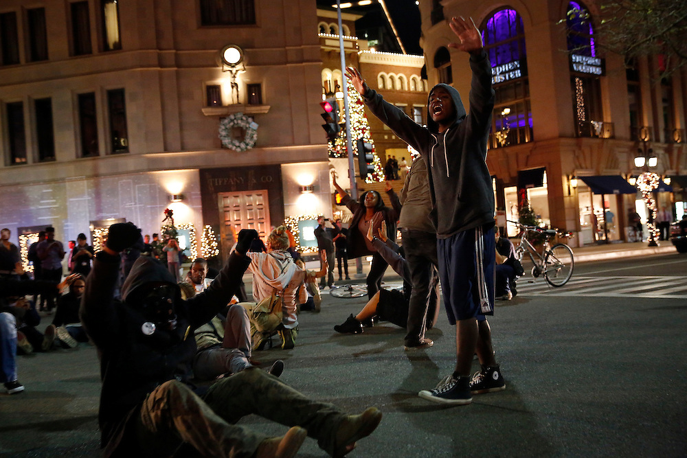 Protestors lie down and block traffic at Wilshire Blvd and Rodeo Drive in Beverly Hills on Monday, November 24, 2014 in Beverly Hills, Calif. (Patrick T. Fallon/ For the Los Angeles Times)