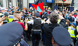 """Police push back against anti-fascist counter protesters at Cavendish Square as several hundred protesters in London in central London demand the release of """"political prisoner"""" right wing talisman Stephen Yaxley-Lennon  - also known as Tommy Robinson, who was imprisoned for contempt of court. London, August 03 2019."""