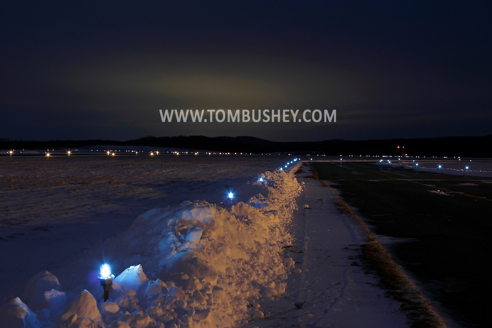 Montgomery, New York  - Lights illuminate the runways at Orange County Airport on the night of Jan. 22, 2012.