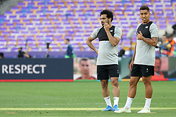 May 25, 2018 - Kiev, Ukraine - Liverpool's Mohamed Salah, left, and Roberto Firmino  during a training session at the Olimpiyskiy Stadium in Kiev. Ukraine, Friday, May 25, 2018 Tomorrow will be the final match of the Champions League between Real Madrid and Liverpool at the Olympic Stadium in Kiev. (Credit Image: © Danil Shamkin/NurPhoto via ZUMA Press)
