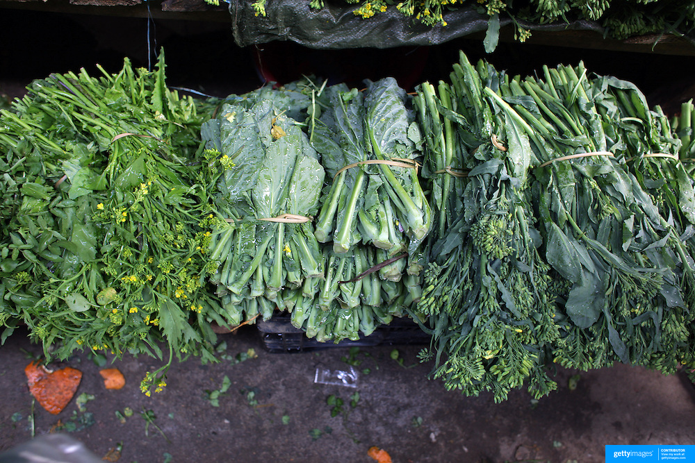 Fresh asian greens for sale at Sapa market, Northern Vietnam.  Sapa and the surrounding highlands are close to the Chinese border in Northern Vietnam and is inhabited by highland minorities including Hmong and Dzao groups. Sapa is now a thriving tourist destination for travelers taking the night train from Hanoi. Sapa, Vietnam. 16th March 2012. Photo Tim Clayton