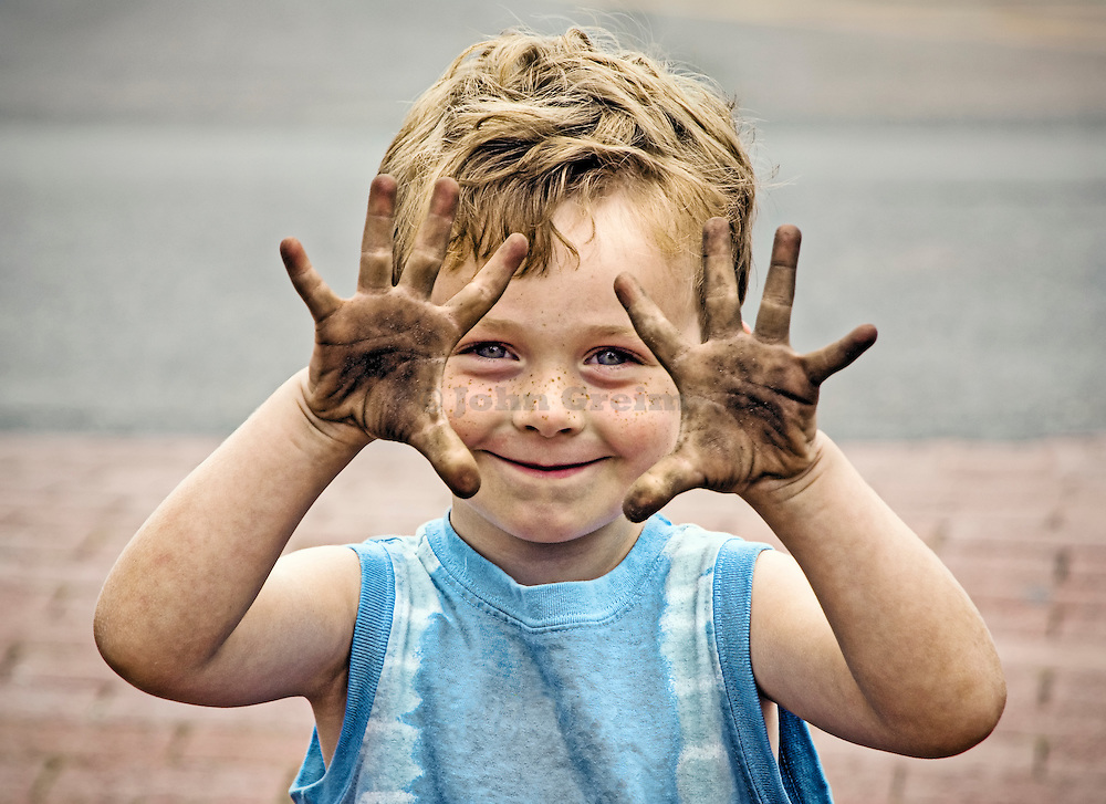 Boy with dirty hands.