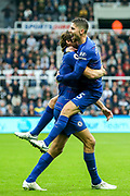 Jorginho (#5) of Chelsea celebrates with Marcos Alonso (#3) of Chelsea following Chelsea's second goal, an own goal conceded by DeAndre Yedlin (#22) of Newcastle United during the Premier League match between Newcastle United and Chelsea at St. James's Park, Newcastle, England on 26 August 2018.