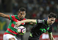 Maritimo´s player Dyego Sousa (L ) fights for the ball with Sporting's player Paulo Oliveira   (R ) during Portuguese First League football match Maritimo vs Sporting held at Barreiros Stadium, Funchal, Portugal, 21 January, 2017.  EPA / GREGÓRIO CUNHA