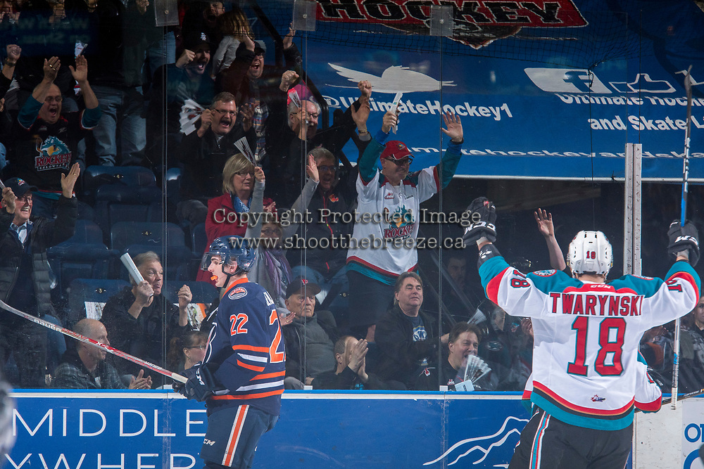 KELOWNA, CANADA - MARCH 24: Carsen Twarynski #18 of the Kelowna Rockets celebrates a goal with fans against the Kamloops Blazers on March 24, 2017 at Prospera Place in Kelowna, British Columbia, Canada.  (Photo by Marissa Baecker/Shoot the Breeze)  *** Local Caption ***