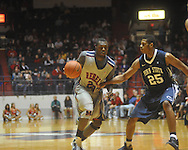 "Ole Miss guard Nick Williams (20) dribbles against Penn State forward Jeff Brooks (25) at the C.M. ""Tad"" Smith Coliseum on Friday, November 26, 2010. Ole Miss won 84-71."