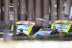 © Licensed to London News Pictures. 19/10/2019. London, UK. Police at New Palace Yard at the Houses of Parliament in Westminster, London where an intruder has reportedly been detained by police, on the day that Parliament will vote on a new agreement between UK government and the EU on Brexit. Parliament is sitting on a Saturday for the first time since 1982. Photo credit: Ben Cawthra/LNP