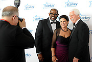 "Gala honoree Forest Whitaker poses for a picture with Starkey Hearing Foundation founders Bill and Tani Austin on the red carpet at the Starkey Hearing Foundation's ""So the World May Hear"" Awards Gala on Sunday, July 20, 2014 in St. Paul, Minn. The foundation gives away more than 100,000 hearing aids in the U.S. and around the world annually. (Photo by Diane Bondareff/Invision for Starkey Hearing Foundation/AP Images)"
