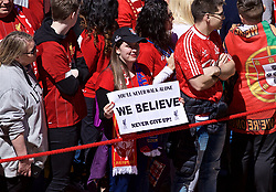 """LIVERPOOL, ENGLAND - Sunday, May 12, 2019: A Liverpool supporter waits for the team bus to arrive with a sign """"We Believe Never Give Up"""" before the final FA Premier League match of the season between Liverpool FC and Wolverhampton Wanderers FC at Anfield. (Pic by David Rawcliffe/Propaganda)"""