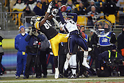 PITTSBURGH - JANUARY 23:  Cornerback Asante Samuel #22 of the New England Patriots goes airborne to break up a pass intended for wide receiver Plaxico Burress #80 the Pittsburgh Steelers during the AFC Championship game at Heinz Field on January 23, 2005 in Pittsburgh, Pennsylvania. The Pats defeated the Steelers 41-27. ©Paul Anthony Spinelli  *** Local Caption *** Asante Samuel; Plaxico Burress