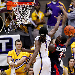 November 23, 2011; Baton Rouge, LA; South Alabama Jaguars guard Xavier Roberson (3) shoots over LSU Tigers guard Anthony Hickey (1) during the second half of a game at the Pete Maravich Assembly Center. South Alabama defeated LSU in overtime 79-75. Mandatory Credit: Derick E. Hingle-US PRESSWIRE