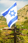 Israel, Maagan Michael, Israeli flag on top of distance signs to various capitol cities around the world