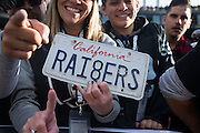 Oakland Raiders fans show off a California license plate during a NFL game against the Carolina Panthers at Oakland Coliseum in Oakland, Calif., on November 27, 2016. (Stan Olszewski/Special to S.F. Examiner)