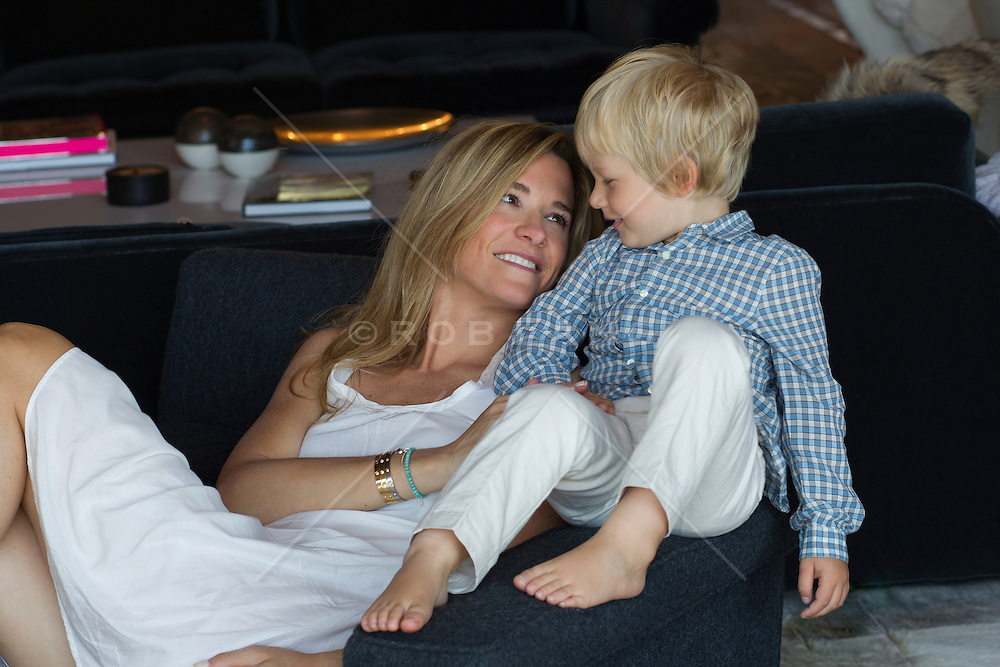 woman at home with her son enjoying time together