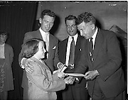 27/05/1959<br /> 05/27/1959<br /> 27 May 1959<br /> Gael-Linn Concert and Singing Competition in the Town Hall, Nenagh, Co. Tipperary, in which R.E. singers and harpists took part. Maire Ní Mhisteil, (11) receiving a £5 cheque, as joint 1st prize winner from Mr J.P. Flynn, Tipperary County Manager. Also included are Diarmuid O Broin (left), Gael-Linn National Organiser and Breandan O Ciobhain, Radio Eireann Singer.