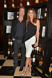 CINDY CRAWFORD and RANDE GERBER at the London launch of Casamigos Tequila hosted by Rande Gerber, George Clooney & Michael Meldman and to celebrate Cindy Crawford's new book 'Becoming' held at The Beaumont Hotel, Brown Hart Gardens, 8 Balderton Street, London on 1st October 2015.