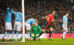 MANCHESTER, ENGLAND - Tuesday, January 19, 2010: Manchester United's Ryan Giggs celebrates scoring the opening goal against Manchetser United during the Football League Cup Semi-Final 1st Leg at the City of Manchester Stadium. (Photo by David Rawcliffe/Propaganda)