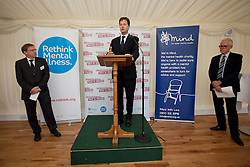 © Licensed to London News Pictures. 10/10/2013. London, UK. The deputy prime minister, Nick Clegg (C), talks to guests at a Parliamentary reception hosted by mental health charities 'Time to Change', 'Mind' and 'Rethink Mental Illness' in London today (10/10/2013). (Also pictured: Paul Farmer (L) Chief Executive of Mind and Norman Lamb (R) Care and Support Minister). The event held on 'World Mental Health Day' saw the Deputy Prime Minister, Nick Clegg, and the Care and Support Minister, Norman Lamb, joined by cross party MP's and peers, reinforce the need to tackle the stigma and discrimination surrounding mental health problems.  Photo credit: Matt Cetti-Roberts/LNP