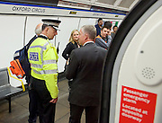 Sadia Khan at London's Night Tube launch at Brixton tube station, London, Great Britain <br /> 19th August 2016 <br /> <br /> British Transport Police Chief Constable Paul Crowther, OBE<br /> talking to Mike Brown MVO Commissioner of Transport for London <br /> <br /> <br /> <br /> <br /> Sadia Khan, mayor of London,  launched the first night tube service and travelled on a tube train between Brixton and Walthamstow on the Victoria Line. <br />  <br /> He launched the first 24 hour Friday and Saturday night services on the Central and Victoria lines <br /> <br /> Photograph by Elliott Franks <br /> Image licensed to Elliott Franks Photography Services