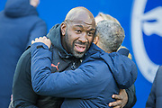 Darren Moore, Head Coach of West Bromwich Albion FC & Chris Hughton, Manager of Brighton & Hove Albion FC greet each other during the FA Cup fourth round match between Brighton and Hove Albion and West Bromwich Albion at the American Express Community Stadium, Brighton and Hove, England on 26 January 2019.