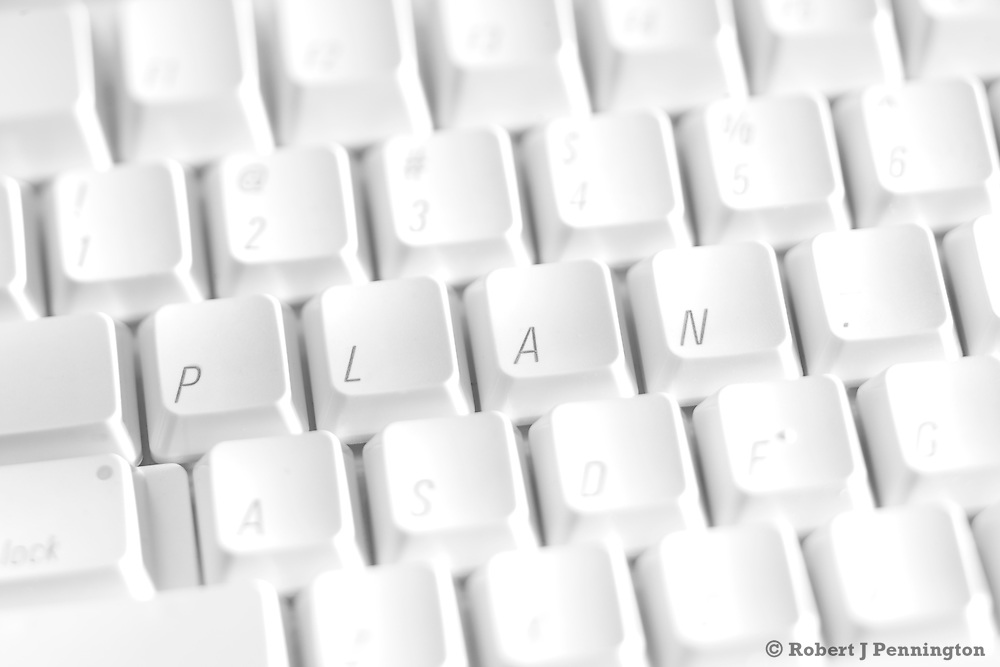 "White keyboard with the word ""Plan"" spelled out."