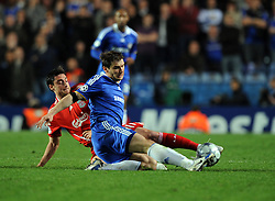 Branislav Ivanovic of Chelsea challenges Albert Riera of Liverpool during the UEFA Champions League Quarter Final Second Leg match between Chelsea and Liverpool at Stamford Bridge on April 14, 2009 in London, England.