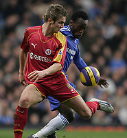 Photo: Lee Earle.<br /> Chelsea v Reading. The Barclays Premiership. 26/12/2006. Reading's Kevin Doyle (L) battles with Michael Essien.