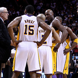 March 10, 2011; Miami, FL, USA; Los Angeles Lakers head coach Phil Jackson talks to his team during the fourth quarter against the Miami Heat at the American Airlines Arena. The Heat defeated the Lakers 94-88.   Mandatory Credit: Derick E. Hingle