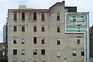 National Car Rent sign on an old tenement building 2nd ave and 80st street looking east.