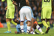 Manchester City forward Sergio Aguero (10) attends to the injured Manchester City midfielder Raheem Sterling (7) during the Champions League match between Manchester City and Dinamo Zagreb at the Etihad Stadium, Manchester, England on 1 October 2019.
