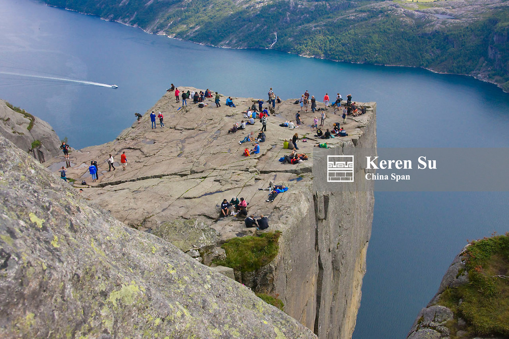 Tourists on Preikestole, Pulpit Rock, Lysefjorden below, Forsand, Rogaland, Norway