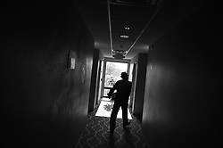"WILSON, NC  - JUNE 7: Billy Kaye walks back to his hotel room in Wilson, NC, June 7, 2018, after finishing a sound check for his upcoming concert at the Vollis Simpson Whirligg Park. He will change his clothes one more time to look as his best. Appearance is important for Billy. Like many other Jazz musicians of his generation he follows the rule ""you are always first seen before heard"". Kaye is visiting his hometown where he will perform for the first time. His performance will be part of a two-day long celebration, organized by The North Carolina Arts Council, The Arts Council of Wilson, The Vollis Simpson Whirligig Park, and The Jazz Revival Project, of his life and achievements as one of the US's most legendary Jazz drummers. (Astrid Riecken)"