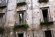 Naples, Italy, November 21, 2006-Decaying balconies and doorways along a narrow alley.
