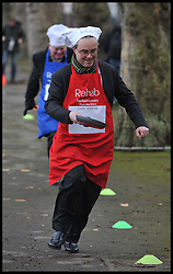 Channel 4 Gary Gibbon takes part in the MP's and Lords race against political Journalist in the Rehab Parliamentary Pancake Shrove Tuesday race a charity event which sees MPs and Lords joined by media types in a race to the finish. Victoria Tower Gardens, Westminster, Tuesday February 12, 2013. Photo By Andrew Parsons / i-Images