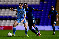 Michael Rose of Coventry City is marked by Victor Adeboyejo of Bristol Rovers  - Mandatory by-line: Ryan Hiscott/JMP - 14/01/2020 - FOOTBALL - St Andrews Stadium - Coventry, England - Coventry City v Bristol Rovers - Emirates FA Cup third round replay