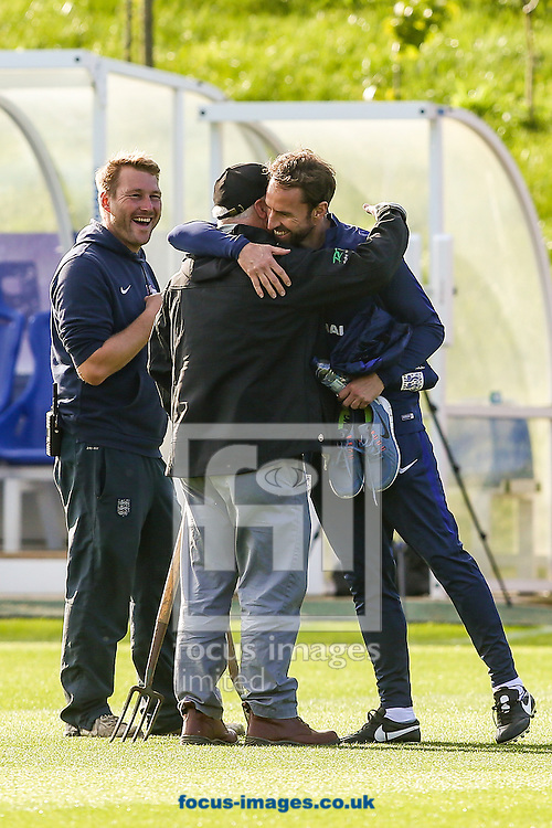 Gareth Southgate, caretaker England manager, is embraced by the St George's Park groundstaff during the England training session at St Georges Park, Burton upon Trent<br /> Picture by Andy Kearns/Focus Images Ltd 0781 864 4264<br /> 04/10/2016