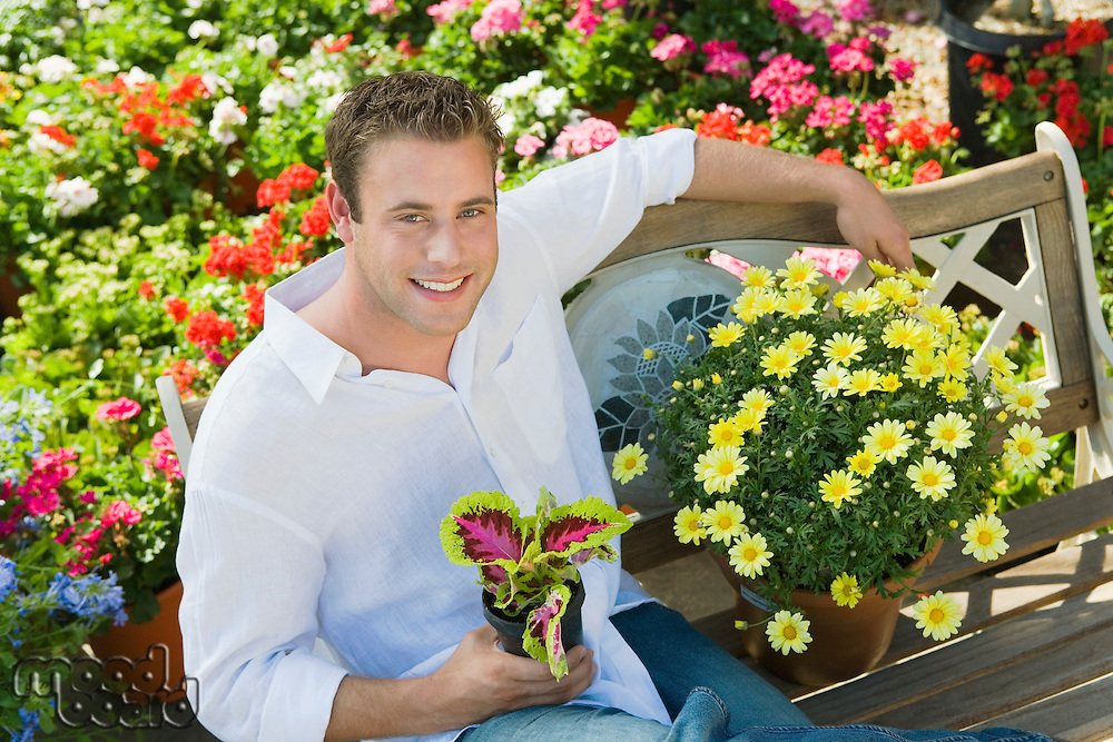 Young Man at Garden Store