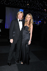 NICKY CLARKE and KELLY SIMPKIN at the annual Collars & Coats Gala Ball in aid of Battersea Dogs & Cats Home held at Battersea Evolution, Battersea Park, London on 11th November 2011.