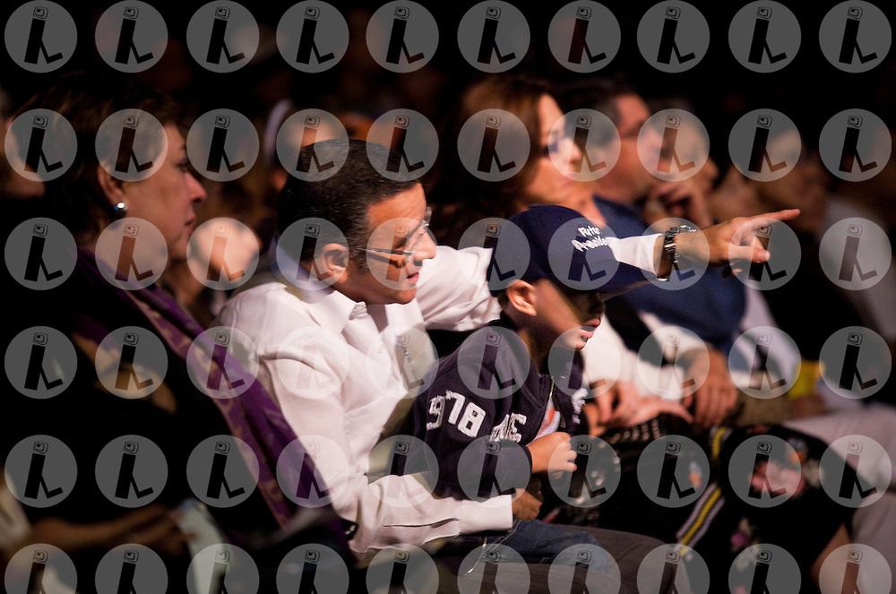 El Salvador's President Mauricio Funes holds his son Gabriel Funes Pignato as they watch a concert by the Youth Symphony Orchestra in San Salvador, El Salvador, Saturday Dec. 18, 2010.(Photo: Edgar ROMERO/Imagenes Libres).