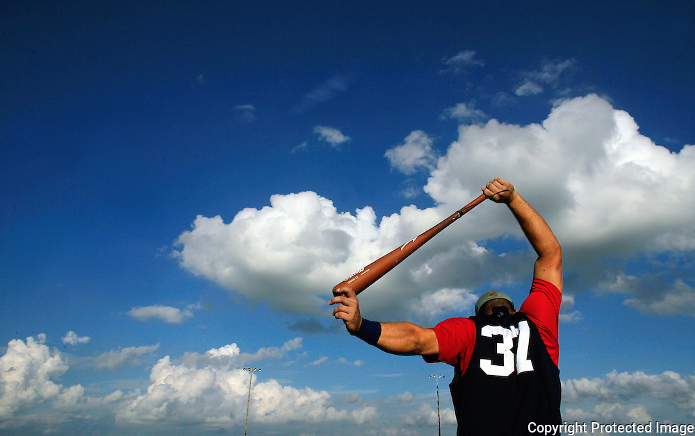 The Clarinda A's Stuart Smith stretches out before a home game with the Omaha Diamond Spirit.  photo by David Peterson