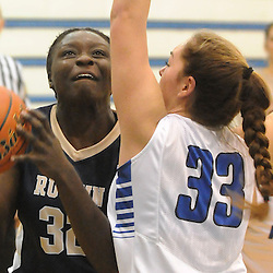 Staff photos by Tom Kelly IV<br /> Rustin's Adashia Franklyn (32) drives towards the hoop past Great Valley's Emilee Kirk (33) during the West Chester Rustin at Great Valley girls basketball game on Thursday night, January 9, 2014.